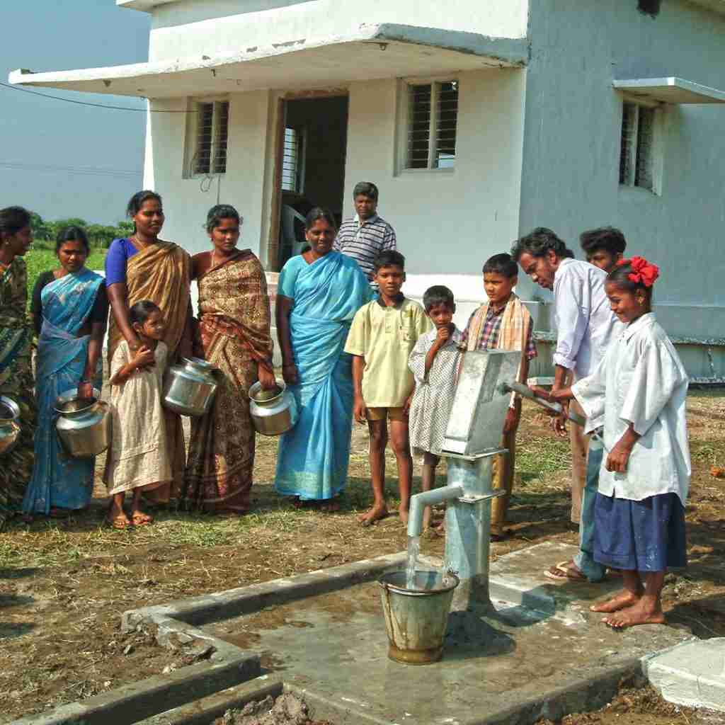 Village drawing clean water from Jesus Well