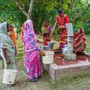 Group of women drawing clean water from GFA World provided Jesus Well